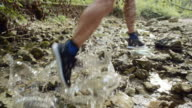 SLO MO Man running in dried creek bed in sunshine video