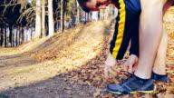 Man running in autumn forest video
