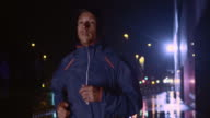 SLO MO Man running in the city at night video