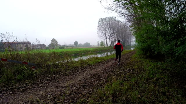 Man running on country road video