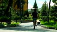 Man running on park road. Running away in slow motion on park alley video