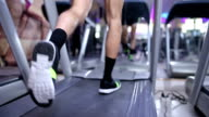 Man running on treadmill in slow motion video