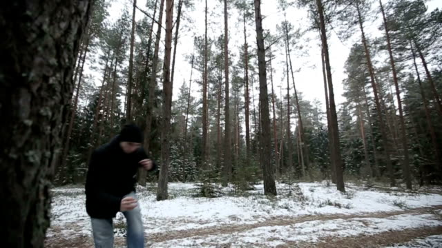 Man running through the woods and doing parkour jump video