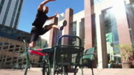 Man runs and leaps over a table video