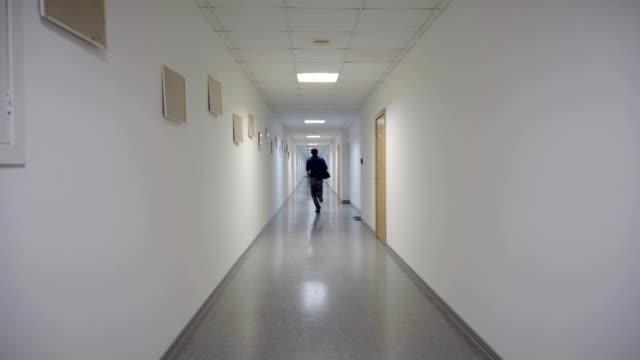 A man runs through a long corridor video