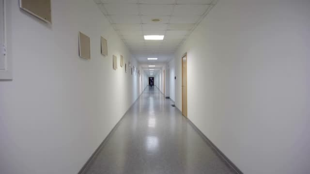 A man runs through a long corridor video
