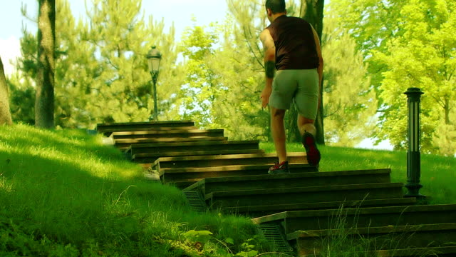Man runs up stairs in slow motion. Fitness man running up stairs video