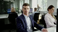 Man satisfied with work. Office interior video