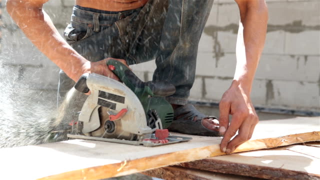 Man saws plank with a circular saw. video