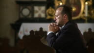 HD DOLLY: Man Saying A Prayer In The Church video