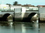 Man scavenging clams in a river of Tavira Portugal video