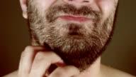 man scratching beard video