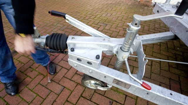 Man Securing Trailer Ready For Hitch video