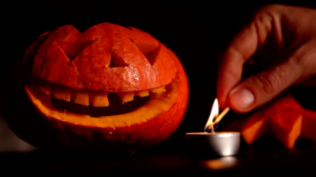 Man set a candle fire for Halloween Jack-o'-lantern video