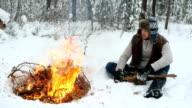 Man Set on Winter Campfire video