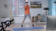 Man shadow boxing for his workout video