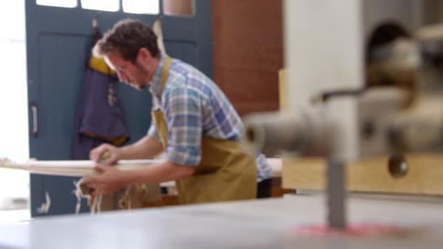 Man Shaping Custom Surfboard In Workshop Shot On RED Camera video