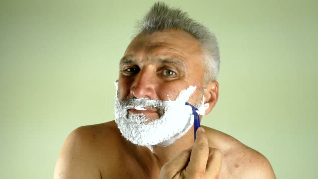 man shaves with a manual razor video