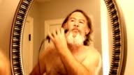 Man shaving beard off fast video