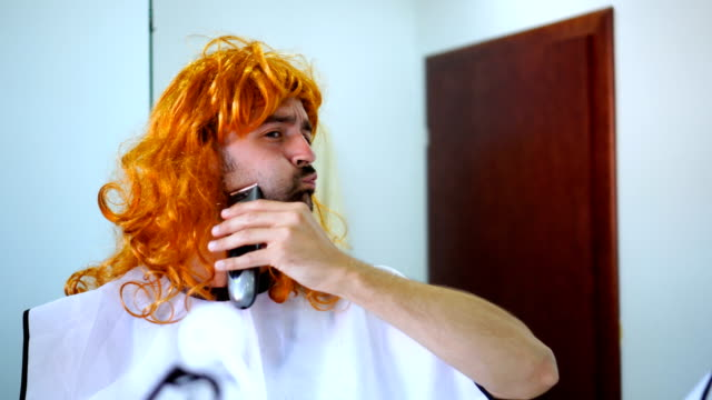 Transgender man shaving his beard video