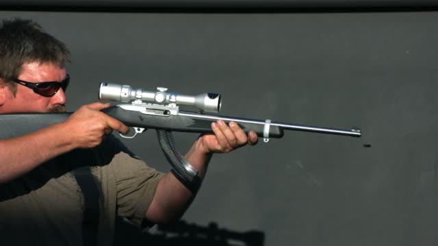Man shooting semi-automatic gun, slow motion video