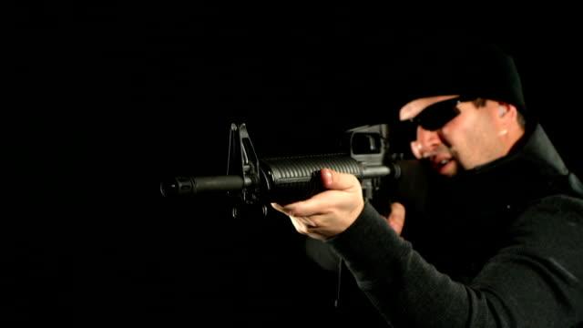 SWAT man shoots assault rifle, slow motion video