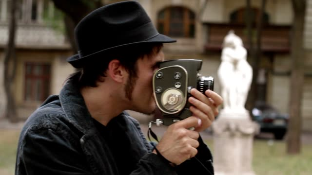 Man shoots film with vintage camera video