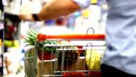 Man shopping in supermarket. video