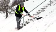 Man shoveling snow on stairs video