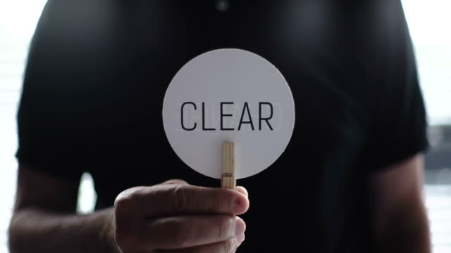 Man showing CLEAR video