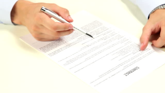 man signing a contract video