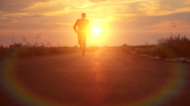Man Silhouette Business Road to Success Runnning Sunset HD video