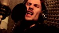 man singing in the Studio video