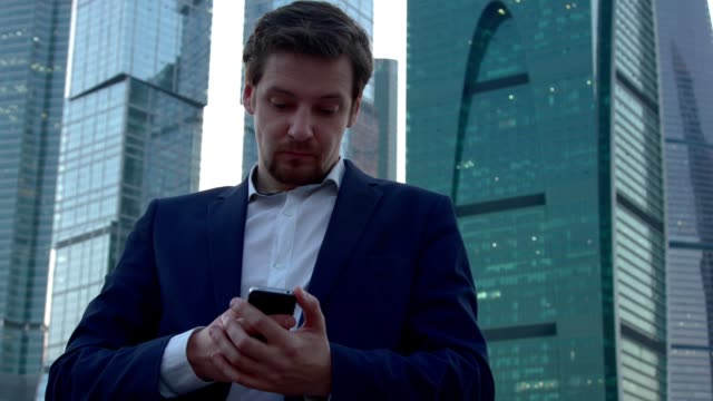 A man sits in social networks with mobile video