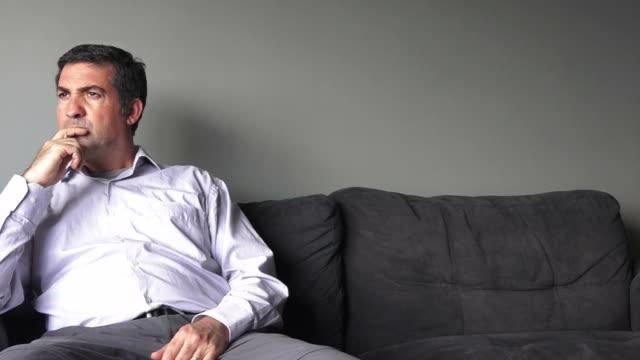 Man sitting on a sofa upset video