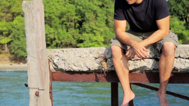 Man Sitting On Jetty Depression Concept Unhappy HD video