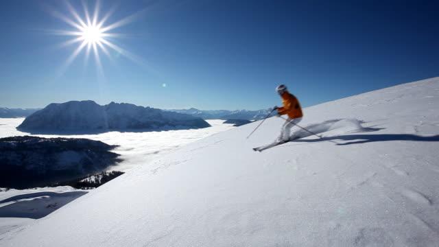 man skiing on fresh snow video