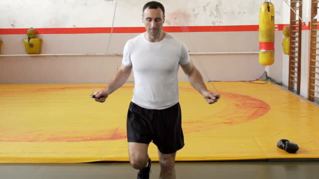 Man skipping rope in slow motion video