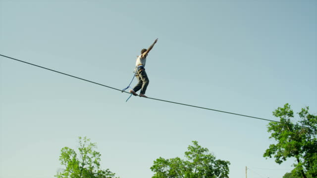 Man slacking on highline above the big urban city video