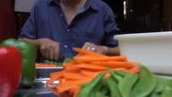 Man slicing carrots video