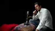Man smoking a water pipe video