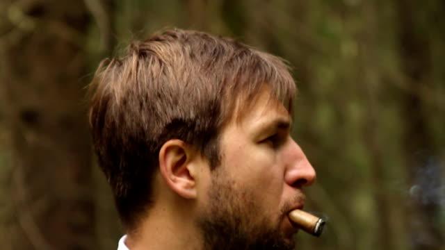 man smoking cigar video