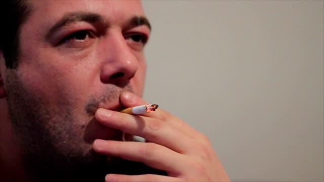 man smoking cigaretts video