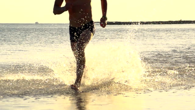 HD SUPER SLOW MO: Man Splashing In Shallow Water video