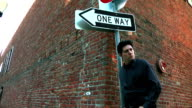 Man standing by one way sign video