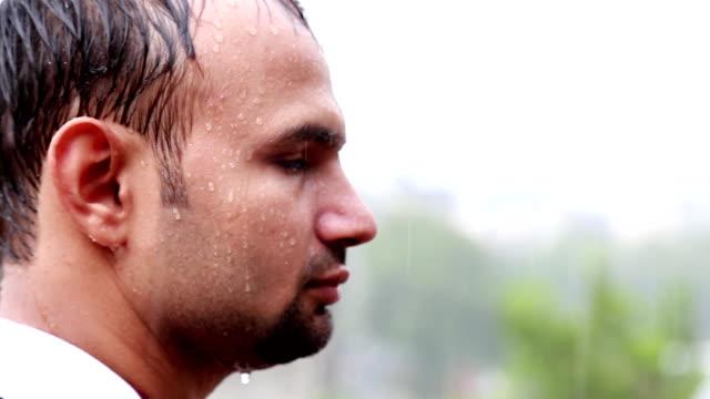Man Standing in the Rain video