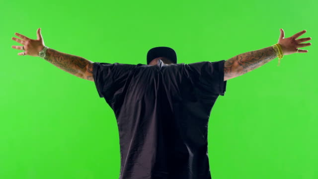 Man standing on green screen field with open arms. Strobe lights. Few shots. Shot on RED EPIC Cinema Camera. video