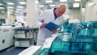 Man stands near laboratory devices video
