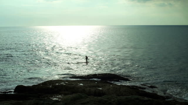 Man Stands On The Paddleboard On The Sea video
