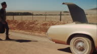 Man starts trip with retro car on dirt road video